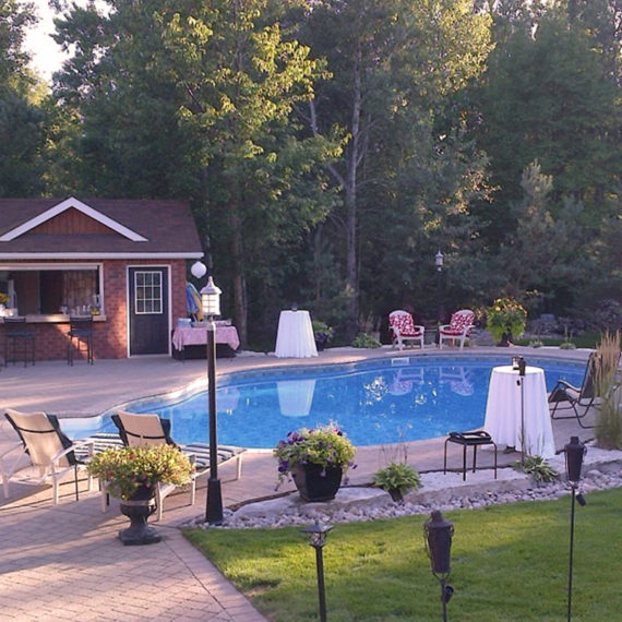 Custom backyard retreat with pool and landscaping